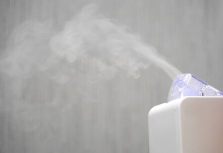 humidifier spraying mist in the air Stockfoto