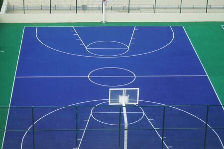close up on empty basket ball field