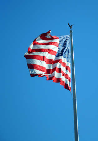 waving USA flag on pole Archivio Fotografico