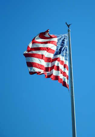waving USA flag on pole Foto de archivo