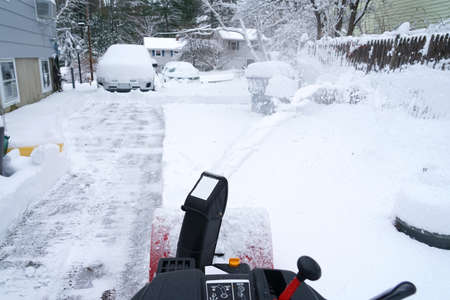 snow blower cleaning snow on the driveway Stok Fotoğraf - 154455796
