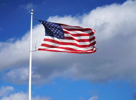 waving USA flag on pole under morning sunlight Stok Fotoğraf