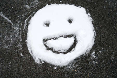 Smile face on the snow in winter after snow