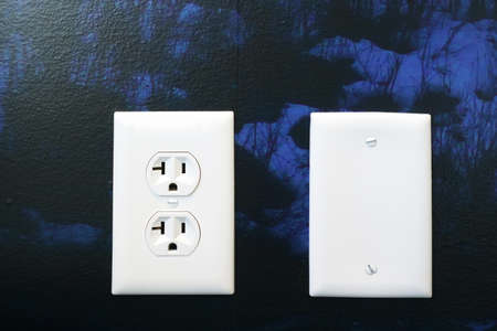 close up on the outlet on painted wall