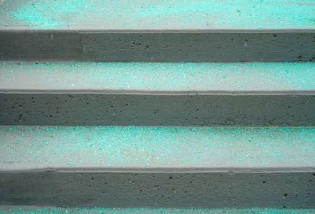 Melting salt on the stair steps in winter season Stok Fotoğraf