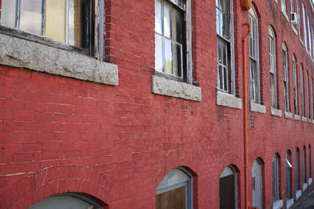 perspective view of old brick wall and window of old factory building Stok Fotoğraf