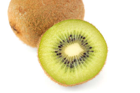 close up on golden half kiwi and whole kiwi isolated on white background