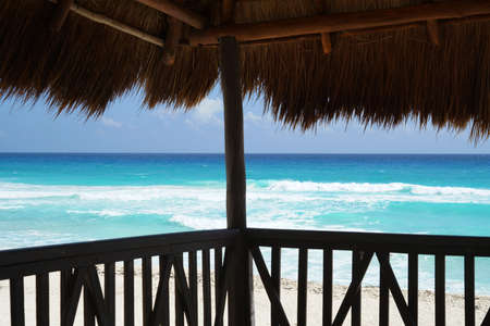 ocean view of blue sea from inside thatch