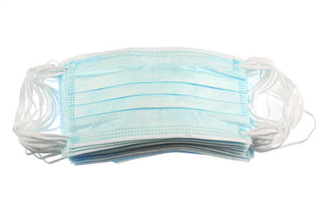 close up on stacking surgical mask isolated on white background