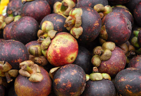 close up on fresh mangosteen fruit as food background