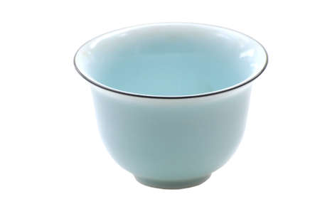 single porcelain cup isolated on white background 免版税图像