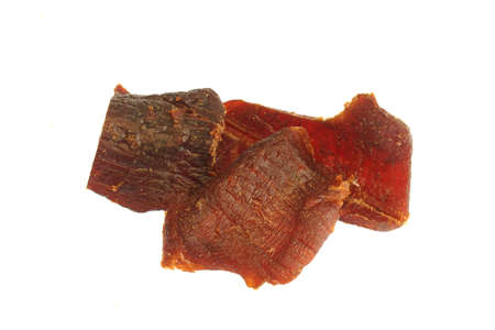 close up on beef jerky isolated on white background