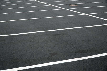 new paved parking lot with new painted strip lines