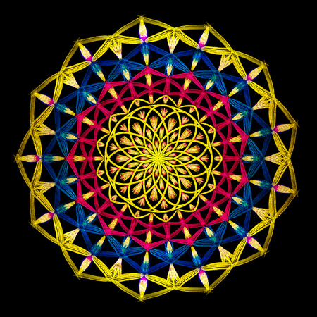 Round blue and yellow mandala on black isolated background. Illustration boho mandala in green and pink colors. Mandala with floral patterns. Yoga template