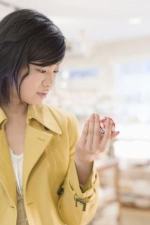 Young woman wearing yellow coat