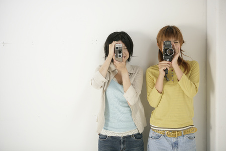 Young women taking videos