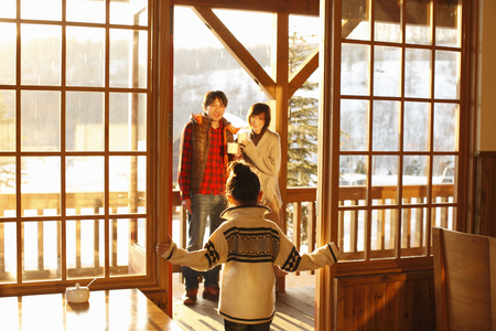 Parents and a child standing on the deck LANG_EVOIMAGES