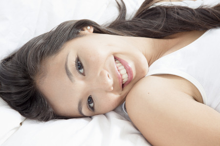 furniture part: Young woman smiling LANG_EVOIMAGES