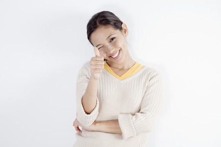 Young woman giving a thumbs-up