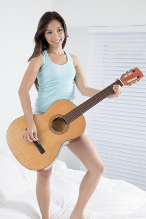 furniture part: Young woman playing the guitar