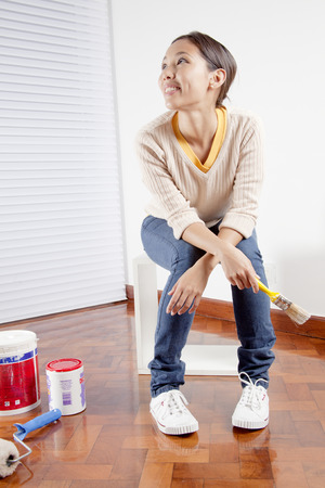 Young woman holding a painting brush