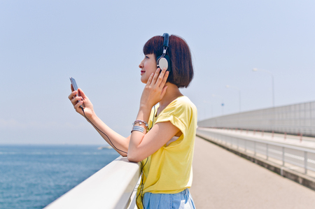 Woman listening to music by smart phone