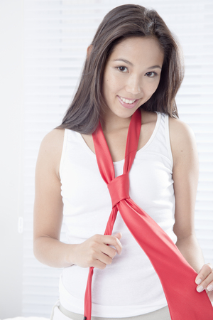 Young woman with red tie