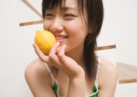 Woman holding out lemon