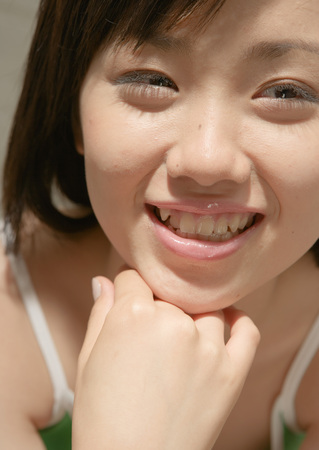Smiling girl with her hand on chin