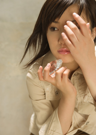 Woman holding glass paper weight LANG_EVOIMAGES