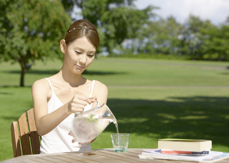 A young woman drinking water