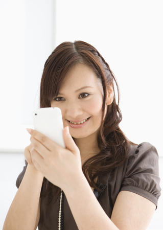 Business woman looking at mobile phone