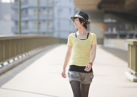 Young woman walking on bridge