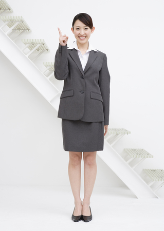 beforehand: Business woman pointing with her finger