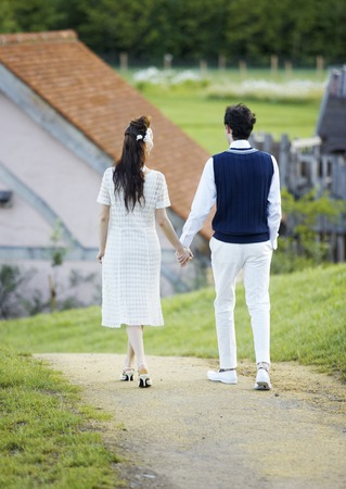 Walking couple holding hands