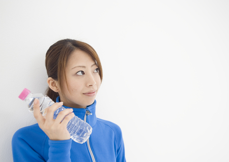 Young woman holding bottle of mineral water