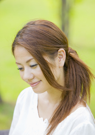 Young woman smiling LANG_EVOIMAGES