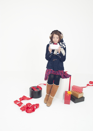 Gifts and young woman LANG_EVOIMAGES