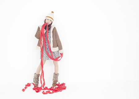 Young woman holding ribbons LANG_EVOIMAGES