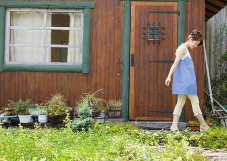 Young woman walking in garden