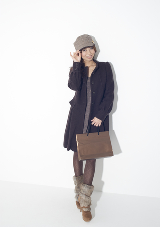 Young woman holding paper bag LANG_EVOIMAGES