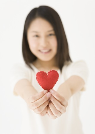 Woman Holding Heart Shaped Object