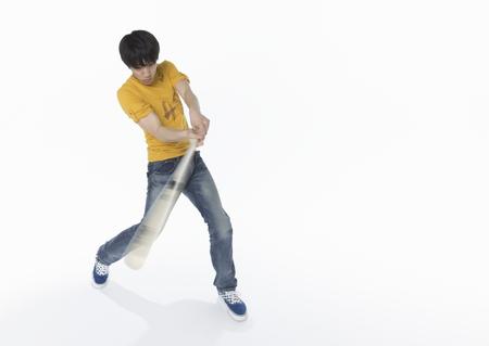 Young man playing baseball LANG_EVOIMAGES