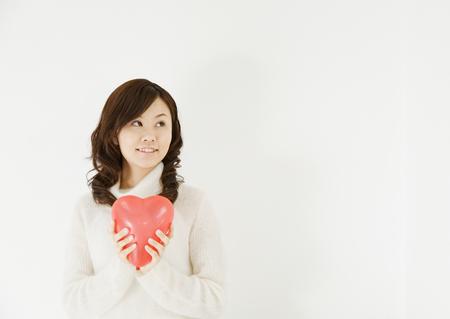 Woman Holding Heart Balloon