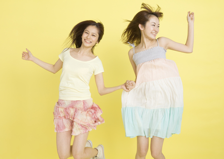 Young women jumping LANG_EVOIMAGES