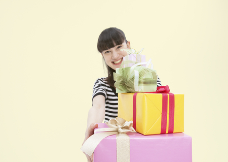 Young woman giving presents