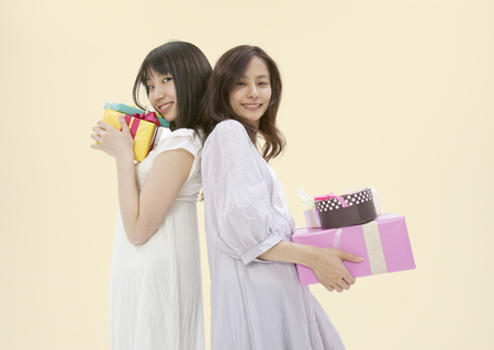 Young women holding presents