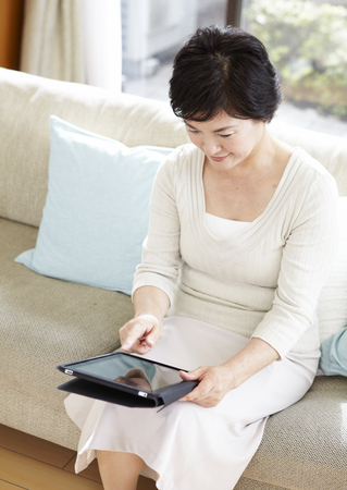 Senior woman using tablet PC