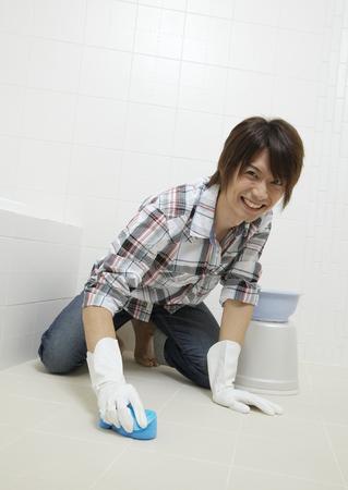Man cleaning bathroom