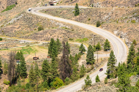 S-curved road in Rocky mountains on summer day Stock Photo